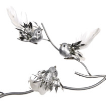 three silver clip on bird Christmas decorations on a branch