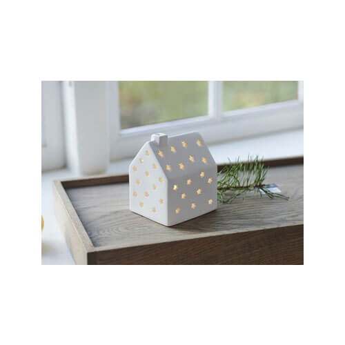 small ceramic white houuuse with LED lights