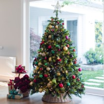 christmas tree decorated with red gold and green decorations