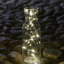 white LED string lights in a glass jar