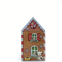 ginger bread house tin side view with dog