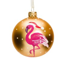 gold glass bauble with white dots and a hot pink flamingo wearing a santa hat