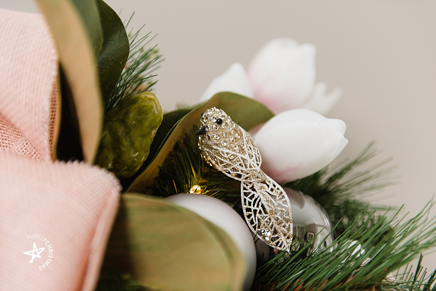 champagne gold bird clipped into a garland
