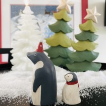 set of 2 wooden penguins a parent and child side view