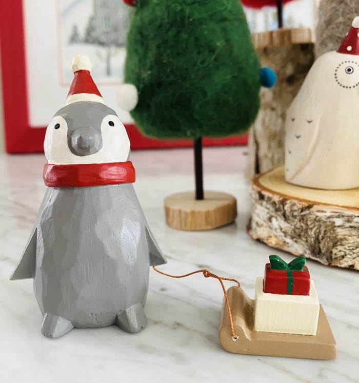 christmas penguin with sleigh with present on top