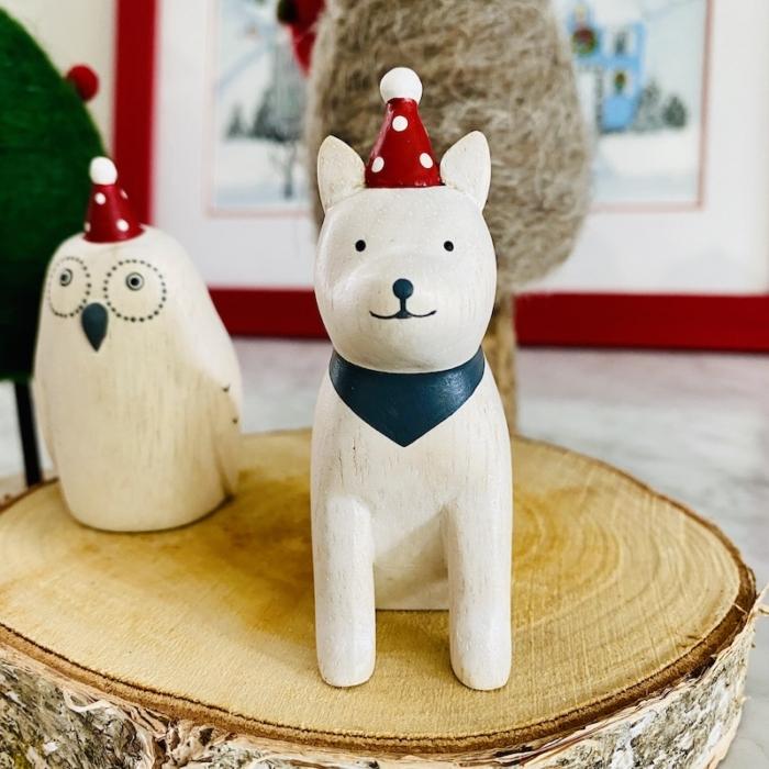 akita christmas dog with wooden owl