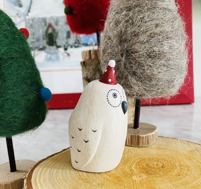 side view of polepole wooden christmas owl