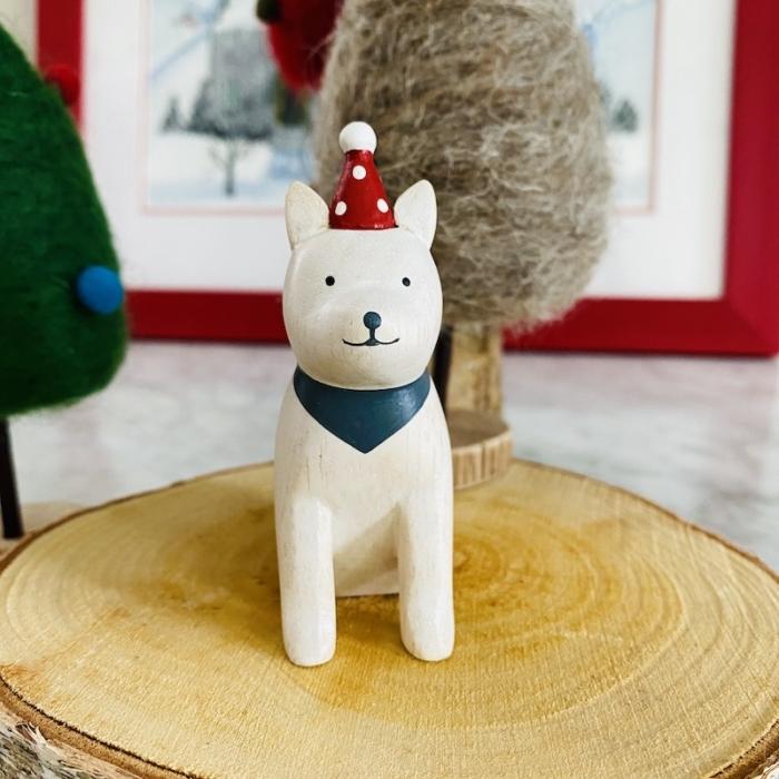 white Akita dog wearing christmas hat