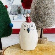 white wooden small owl with christmas hat