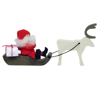 wooden santa on sleigh with reindeer