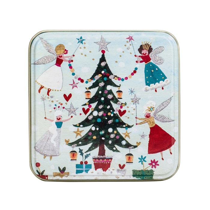 small tin with christmas tree and fairies