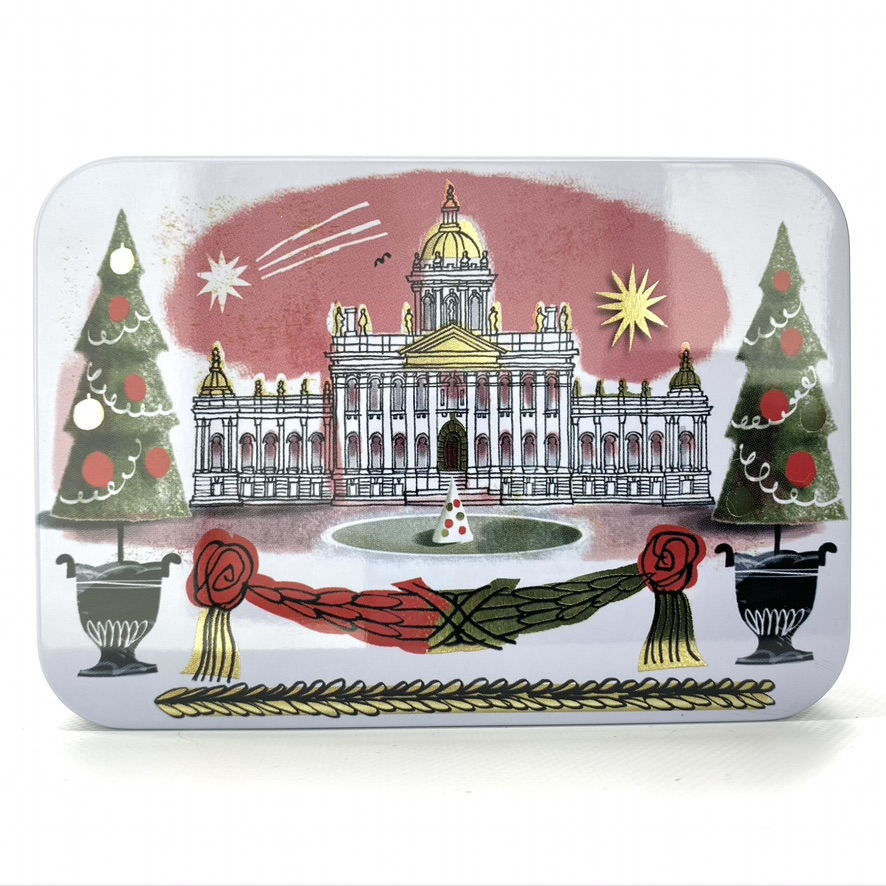 christmas petite tin with topiary trees and elegant building