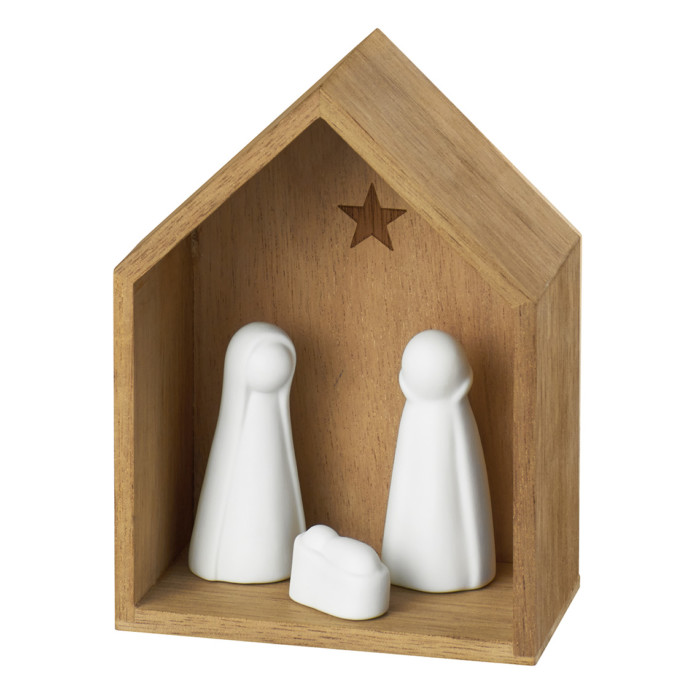 small wooden manger and three figures in nativity