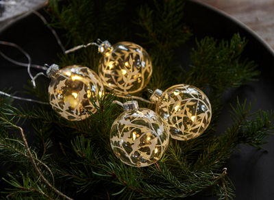 glass LED baubles with holly pattern